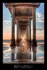 Under the Pier (Chad McDonald) Tags: ocean california ca light sunset sky sun beach water skyline photoshop canon reflections concrete pier interesting sand waves pacific sandiego chad under pillar salt tunnel lajolla pacificocean column lajollashores s
