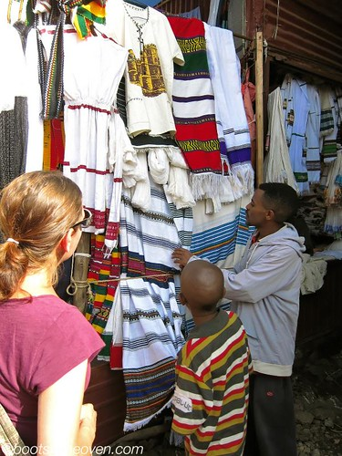 Looking over cloth with one of our child guides