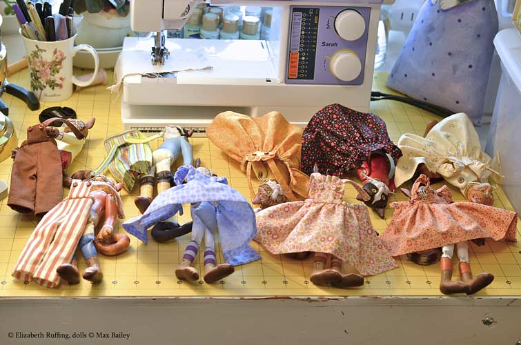 Photographing art dolls, dolls organized with their outfits, photo by Elizabeth Ruffing