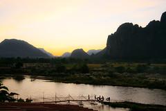 Taking in an amazing Sunset in Vang Vieng, Laos (Joe Fenton) Tags: sunset people mountains travelling water silhouette river landscape backpacking laos mekong vangvieng smalltown localpeople americanairbase