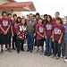 Navajo Nation President Ben Shelly and First Lady Martha Shelly with the Shiprock High School Chieftain Cross Country Team. Start of the Chieftain Mile Run at the 100th Northern Navajo Fair in Shiprock, NM. Photo by Jared King / NNWO.  This Navajo Nation Washington Office photograph is being made available only for publication by news organizations and/or for personal use printing by the subject(s) of the photograph. The photograph may not be manipulated in any way and may not be used in commercial or political materials, advertisements, emails, products, promotions that in any way suggests approval or endorsement of Navajo Nation President Ben Shelly.