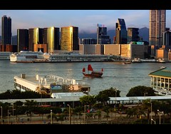 Red Sails in the Sunset | Hong Kong Harbour (I Prahin | www.southeastasia-images.com) Tags: sunset red urban water buildings hongkong boat junk ship harbour jetty sails kowloon chinesejunk victoriaharbour starcruise aqualuna centralpiers