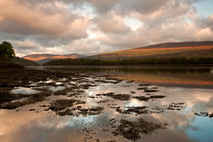 Sun Over Loch Eil (mark_mullen) Tags: morning mountain lake seaweed beautiful beauty reflections landscape scotland countryside early scenery earlymorning hills serene loch tranquil rugged fortwilliam locheil scottishhighlands drumsallie kinlocheil 24105f4is achaphubuil leendgrad markmullen markmullenphotography canon1dsmk2mkii bandofsunlight