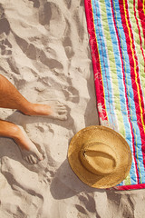 Summer Hat (Alex Bramwell) Tags: towel blanket beach hat summer sombrero feet man vertical colorful warm vacation missing mystery conceptual