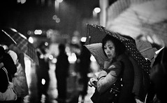 No Easy Money (Jonathan Kos-Read) Tags: portrait storm rain umbrella reflections neon alone shanghai lonely    raining puddles bund bigcity vulnerable goldenratio    atx828afpro tokinaaf80200mmf28 tokina80200matxprof28
