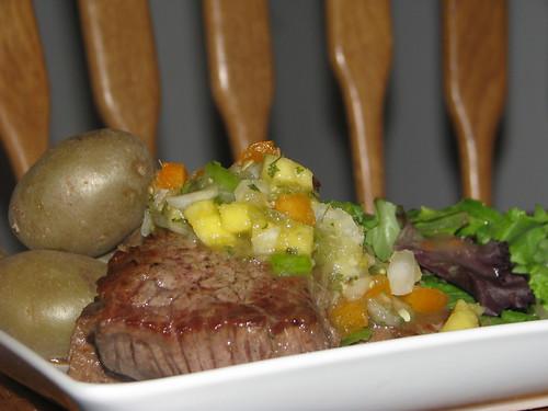 Steaks, boiled potatoes, salsa/relish