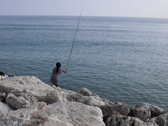 the lady fishing (dmixo6) Tags: holiday spain playa andalucia dugg dmixo6