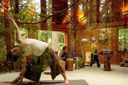 Standing triangle yoga practitioner, children playing drums, activity room, Breitenbush Hot Springs, Breitenbush, Marion County, Oregon, USA by Wonderlane
