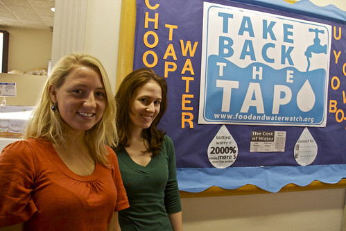 Jessica Wilhelm, President, and Jen Tracy-O'Connor, Vice President, of Take Back the Tap put up a bulletin board for the club in Campus Center.