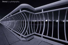 The BiG ArrOw . . . <= (Beauty Eye) Tags: blackandwhite bw white seascape black beach beautiful fence dark walking nice bridges bubble arrow quite dslr infinate muscat cycles endless 10mm       qurum blackwhitephotos     beautyeye