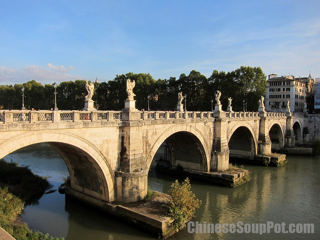 [photo-bridge of angles over tiber river rome]