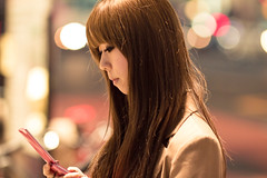 Thinking of You (Fesapo) Tags: street urban woman hot mobile japan night canon hair asian prime lights tokyo pretty dof eyelashes bokeh feminine candid shibuya cellphone 7d   thinkingofyou onmymind 135mmf2l