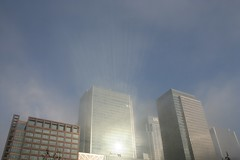 Sunlight beams reflected off the tower (IanVisits) Tags: london fog docklands canarywharf