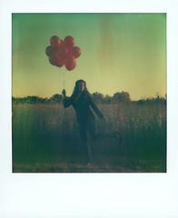 Samantha (.darkchamber.) Tags: film girl analog balloons polaroid sx70 expired tza tzartistic