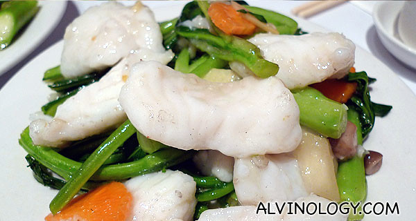 Delicious cod fish stirred fried with veggies