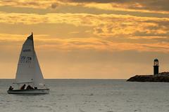 Tramonto (Tiziano Marinelli Photography) Tags: sunset nikon barca tramonto nuvole mare foto tramonti vela sole acqua colori luce aria vento raggi onde temporale nettuno immagini 70200f28 scoglio tizianomarinelli