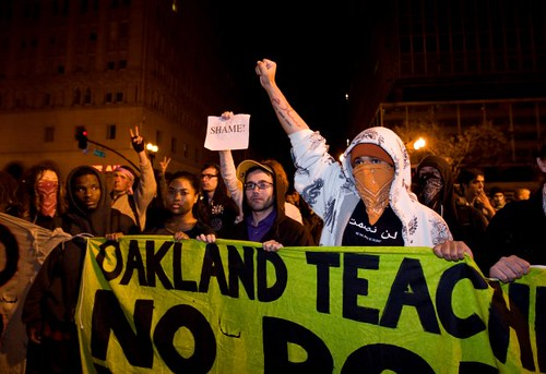 Occupy movement demonstrators in Oakland, California protesting against the removal of hundreds of people from the park that had been the center of anti-capitalist demonstrations.  The Occupy movement has spread throughout the U.S. and the world. by Pan-African News Wire File Photos