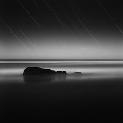 Two Seas (maxxsmart) Tags: california longexposure fall film beach analog sunrise mediumformat stars sand rocks kodak trails moonlight sonomacounty bodegabay startrails hasselblad500cm 2011 400am tmaxdeveloper 80mmf28 salmoncreekbeach 100tmax 4200seconds 14moon maxxsmart 70minutesf56