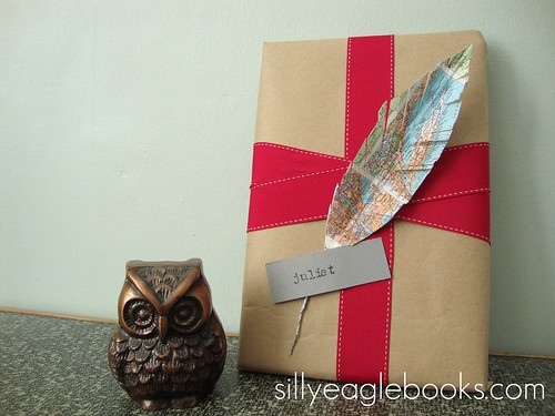 map feather gift topper