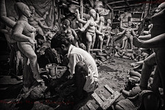 Preparation for Kali Puja : Potuapara, Kolkata [ BW Version ] (Sukanta Maikap Photography) Tags: street india streetphotography diwali kolkata calcutta westbengal kalipuja dipabali tokina1116f28 potuapara goddesskaliidols clayidolshalffinishedidols unfinishedkaliidols canon450dtokinaatxprosd1116mmf28ifdx
