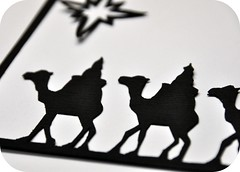 Wise Men (Rosina Huber) Tags: christmas holiday black window silhouette paper star candle cut holly angels outline threewisemen camels papercut babyjesus velum papercuts exactoknife scherenschnitte maryandjoseph craftknife japaneselinen windowtransparency