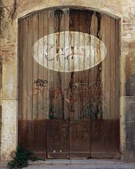 Battered Door (algbailey) Tags: door espaa plants spain nikon paint arch decay neglected rusty weathered nikkor gafitti brickwork reus baixcamp whitewash afs2870mmf28 tonybailey antoinebailey algbailey