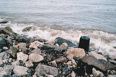 Rocky Shore (Saturated Imagery) Tags: sea copyright film landscape prestatyn fujicolorc200 prakticatl5b donteventhinkofsellingtheseyoumoneygrabbingbastards