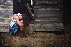 Alone (KellyCosterPhotography) Tags: wood old blue portrait brown abandoned girl hair boards cabin alone sad dress boots curls curly brunette solemn