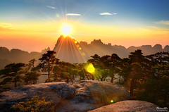 Sunshower (Huangshan) (Andy Brandl (PhotonMix.com)) Tags: china sunset sun nature misty landscape outdoors nikon rocks asia scenic worldheritagesite wilderness pinetrees huangshan lensflares yellowmountain mountainranges anhuiprovince mountainscapes mounthuang d7000 photonmix lpf16 lp2011winners pinushuangshanensis
