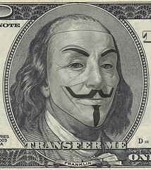 Benjamin Franklin $100 bill portrait with Guy Fawkes mask