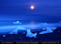 Iceland - Full Moon over Pieces of Ice at Black Sand Beach near Jkulsrln Glacier Lagoon ( Lucie Debelkova / www.luciedebelkova.com) Tags: travel light sunset sky panorama cloud storm cold tourism ice nature water beautiful clouds sunrise wonderful dark landscape outdoors island dawn licht frozen iceland fantastic scenery europe mood view dusk lumire scenic atmosphere paisaje lagoon paisagem glacier arctic beaut stunning vista nordic paysage exploration incredible landschaft breathtaking paesaggio sland jokulsarlon jkulsrln vatnajkull evropa magiclight dramaticlight nordiccountry jokulsarlonglacierlagoon lveldisland capturenature luciedebelkova lpsky breiarmerkurjkull wwwluciedebelkovacom