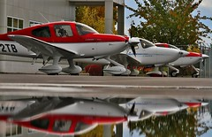 Cirrus Trio (dkuttel) Tags: portland flying aviation pdx cirrus sr22 generalaviation sr20