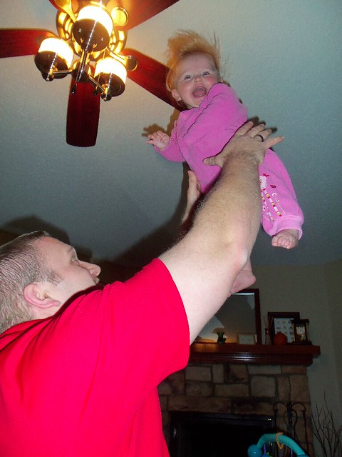 tossing the baby.