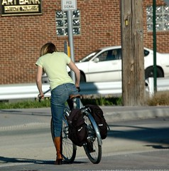 Boots are always in fashion even for bike rides. (kennethkonica) Tags: woman brown standing midwest highheels shadows boots indianapolis spokes mother streetphotography bikes indiana backpacks bluejeans milf hoosiers wpmen usanikond70s