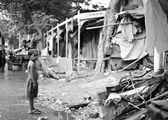 Mumbai, September 1999 (Riverman___) Tags: poverty travel boy blackandwhite india blancoynegro film 50mm md minolta 28mm 400 bombay hp5 mumbai ilford fp4 slum 125 x700 f17 rokkor
