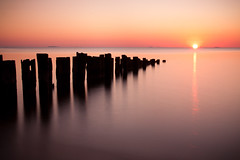 Darkness Retreats (jeffsmallwood) Tags: old longexposure morning sun reflection beach water sunrise dawn bay pier decay jetty maryland maritime northbeach chesapeake chesapeakebay