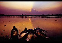 Waiting for the Sun (Shutterfreak ) Tags: light sunset water colors silhouette clouds river landscape boats lyrics ray natural dusk horizon bangladesh thedoors lyrical inkiad