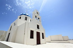 A greek orthodox church at Santorini island (be.image photography) Tags: old travel blue sky sun white building tourism church architecture religious island greek europe mediterranean european bell traditional famous religion aegean culture nobody southern santorini greece caldera dome orthodox oia cyclades thira lowangle santoriniisland oiaia