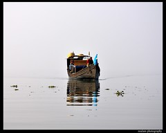 Gliding through water (NSalam) Tags: blue red black water boat nikon d90