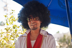 Elvis ~ Afro Style (Ar~Pic) Tags: california halloween canon 50mm costume flickr raw afro dean elvis dressup silverlake laughter haha flickrmeetup swartz sofun ourwaiter alittleblownoutbutyougettheidea ithinkweareallseeninthesunglassreflection