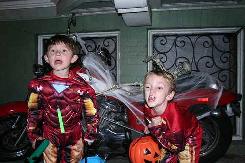 Walker and Jonty make scary faces in front of the spooky motorcycle rider