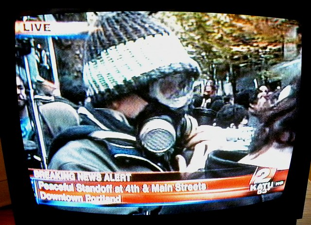 Occupy Portland: protester with gas mask at 4th & Main, 11/13/11 about 3:30 PM on KATU