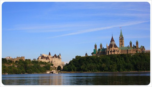 ottawa parliament and chateau laurier hotel from river