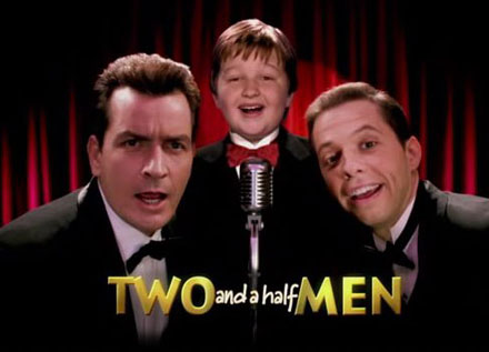 cast of two and a half men--two white men and a white boy singing into a microphone