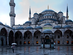 In search for costumers, Blue Mosque - Istanbul (adde adesokan) Tags: street travel blue light people man color rain architecture pen umbrella turkey europe candid streetphotography olympus istanbul mosque trkei mann 12mm bluemosque ep1 streetphotographer m43 mft mirrorless microfourthirds theblackstar mirrorlesscamera streettogs