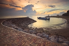 THE CURVE ( another view of Sanur Beach ) (ManButur PHOTOGRAPHY) Tags: ocean morning travel sea sky bali cloud sun beach nature water rock stone sunrise canon indonesia landscape photography eos boat sand scenery aqua asia view natur east filter nd usm curve filters polarizer efs 1022mm hitech cpl sanur polarize gnd f3545 450d