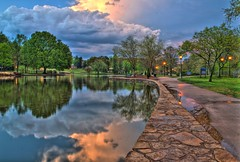 A Stroll In The Park (stevem19) Tags: sunset water reflections pond streetlamps nikondigital charlottenc hdr cloudysky freedompark stevemoore photomatix charlotteparks nikonhdr nikond7000 charlottehdrpictures