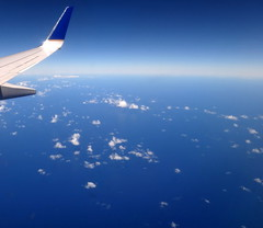 Over the North Pacific Ocean.. () Tags: ocean above sea vacation sky holiday clouds plane airplane island hawaii fly inflight paradise pacific aircraft united flight wing jet continental aerial pacificocean shaka greetings boeing winglet stewardess rtw aereo hangloose vacanze avion 737 unitedairlines roundtheworld winglets flightattendants flightattendant continentalairlines atop globetrotter northpacific airplanewing 737800 areo jetwing airhostess boeing737 staralliance northpacificocean 10days insidetheplane worldtraveler  ario  continentalairways shakasign interiorcabin inthecabin 737800900  hawaii2011