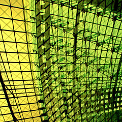 Squaring up (Arni J.M.) Tags: building berlin green glass yellow architecture germany geotagged squares bolts geotag berlinhauptbahnhof nikond80