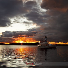 Powerful sky (Barry_Madden) Tags: sunset sky lake clouds reflections suomi finland tugboat powerful saimaa